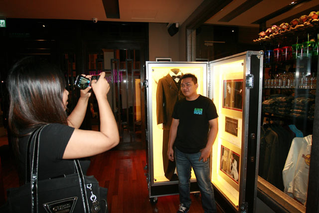 A Hard Rock Cafe Melaka patron posing for a picture with the Justin Timberlake memorabilia