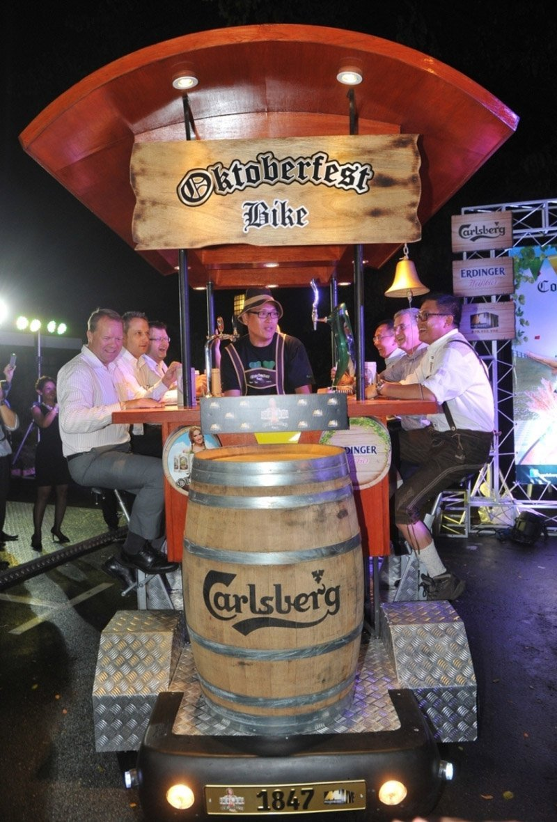 Malaysia's first-of-its-kind Oktoberfest Bier Bike was given a spin by [from left to right] Henrik Juel Andersen, Managing Director of Carlsberg Malaysia; Kai Schlickum, Vice President of Sales & Marketing of Mercedes Benz Malaysia; Kristian Dahl, Supply Chain Director of Carlsberg Malaysia; Seah Kok Leong, Chief Marketing Officer and General Manager of Magnum 4D Berhad; Peter Hourigan, General Manager and Vice President of Saujana Resort Kuala Lumpur; and Kenneth Soh, General Manager of Luen Heng Sdn Bhd.